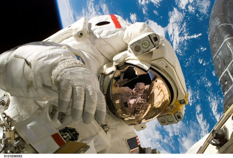 why do Astronauts wear 2 watches